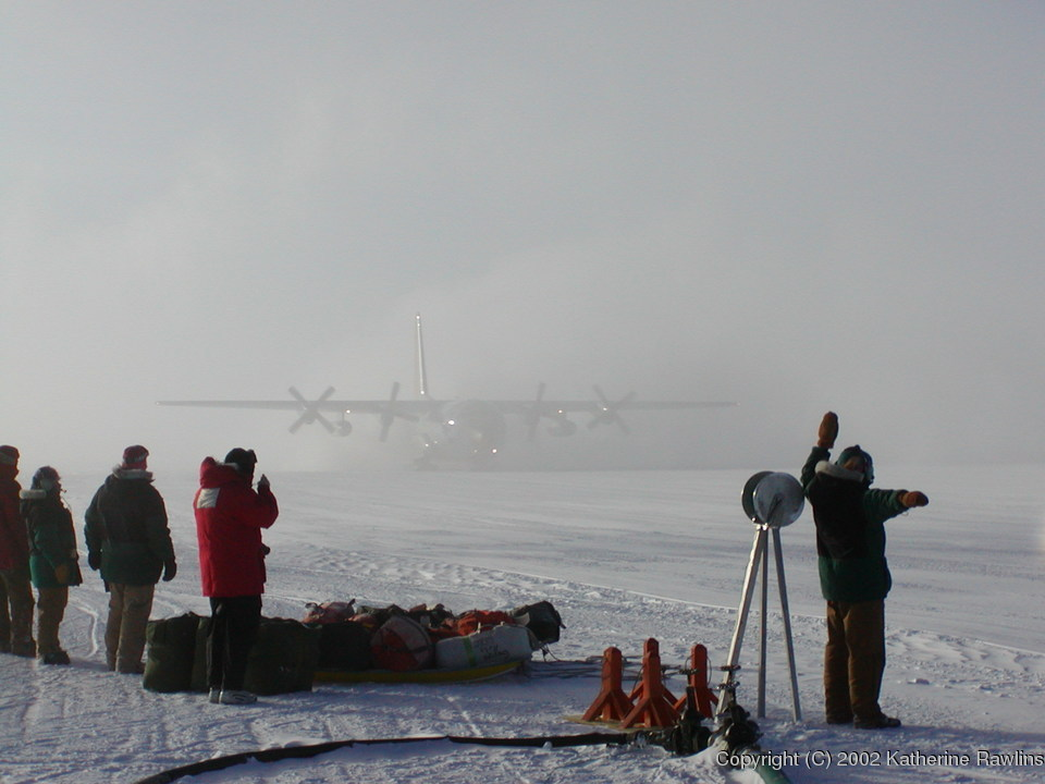 The crew greets the first plane to land at the station after the long winter, in late   October