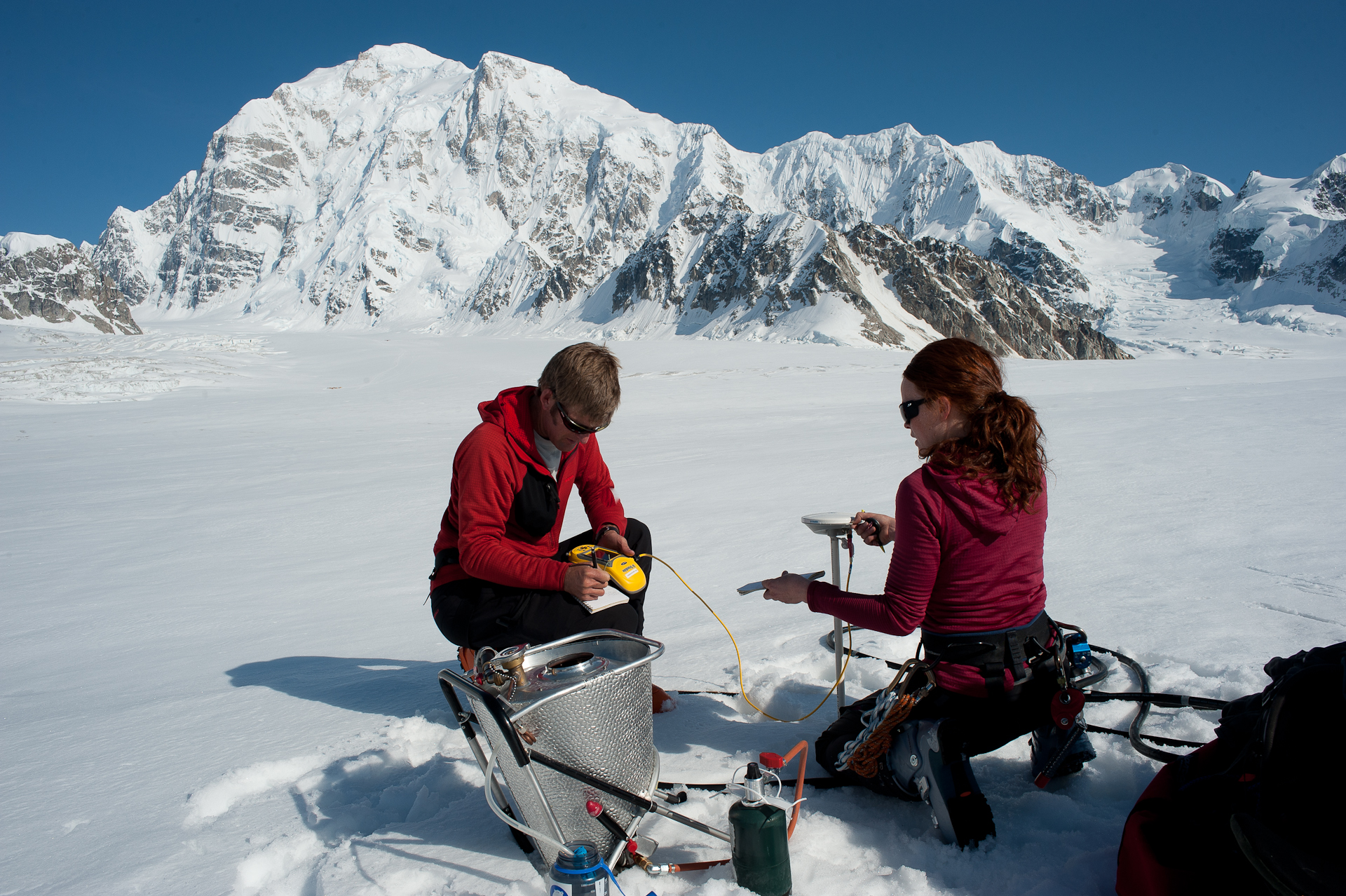 Doing point measurements of mass input through snowfall on the Kahiltna Glacier in Denali National Park,  photo by J. T. Thomas