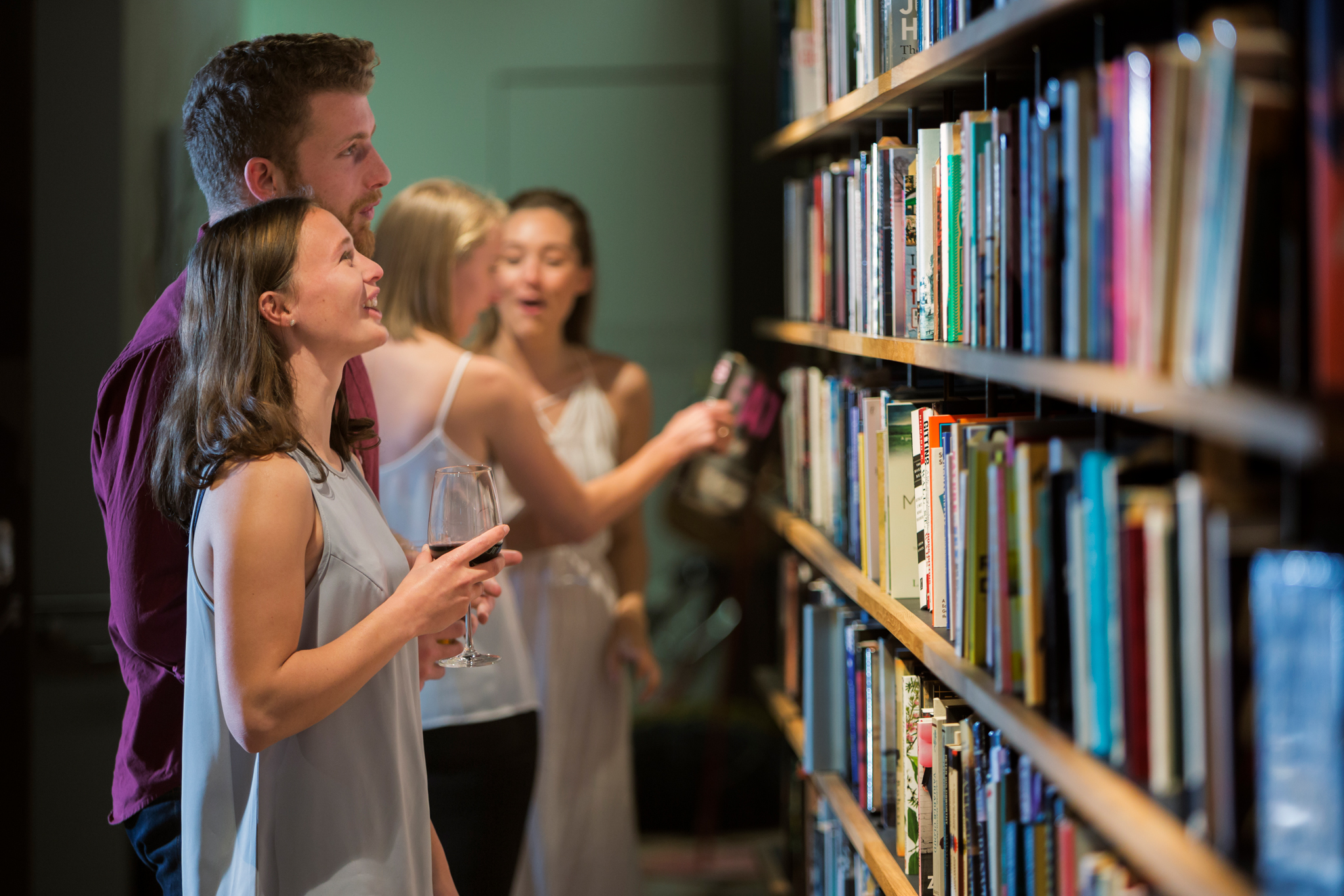 Drink wine in a bookshop