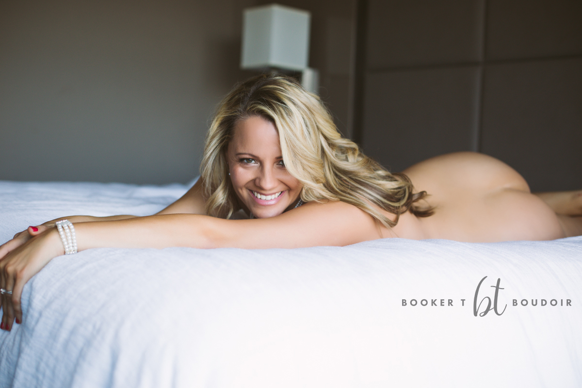 beautiful woman poses for intimate boudoir session