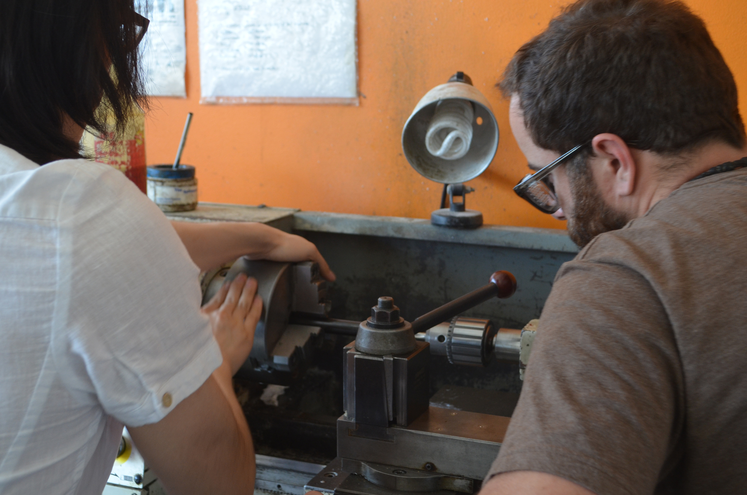 Tapping the axle-receivertubes on the lathe.