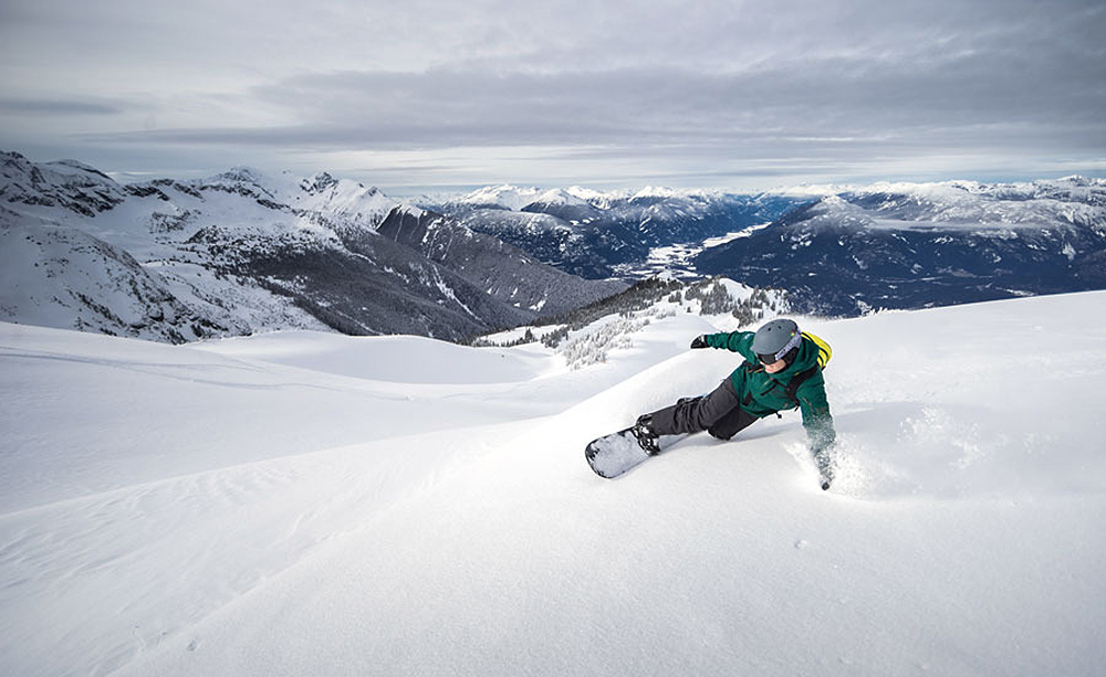 Heli boarding and heli skiing at its finest.