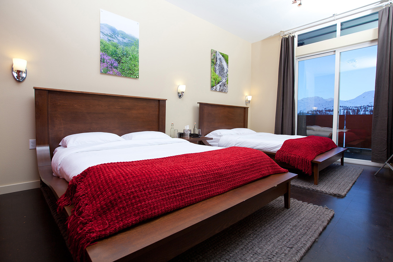 Relax in your luxury room at Tsaina Lodge after a day of heli skiing.