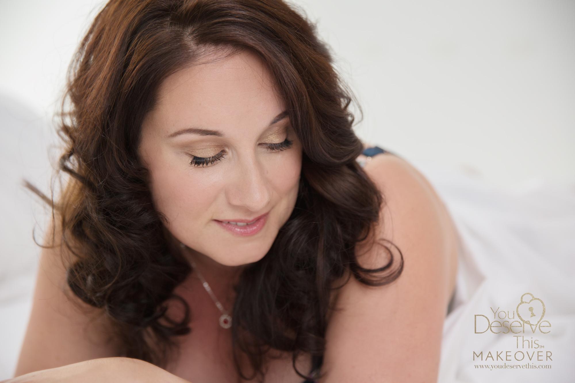 Sensual look down portrait white sheet boudoir portraits for women in london