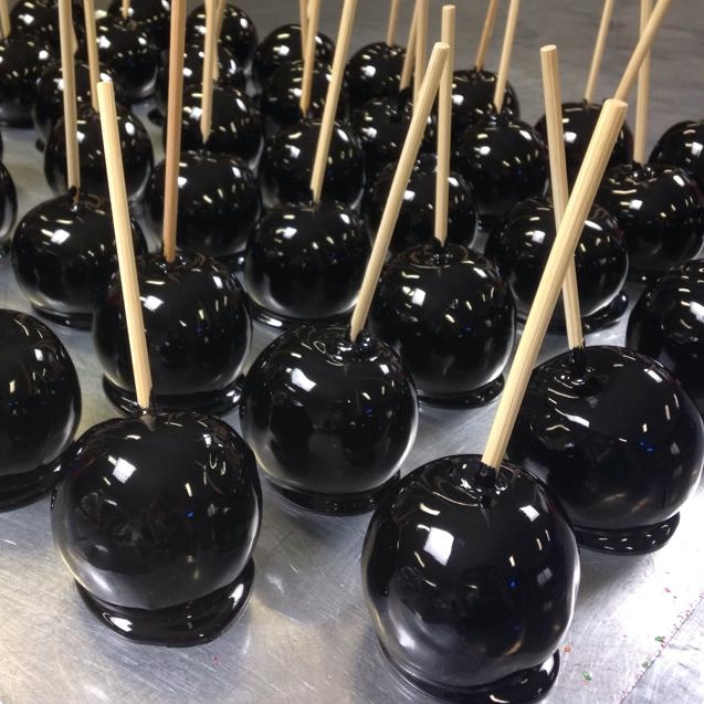 Black toffee apples used for Halloween treats.