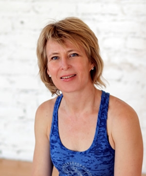 Anna has been practicing and teaching yoga since the 90's. Certified in Vinyasa power yoga style, Anna has taught in the area since 2000. Anna completed an Anusara Immersion with Sue Elkind & Naime Jezzeny in 2008, and her Anusara Teacher Training with them at DIG Yoga in 2010.  Anna's wide range of experience includes teaching yoga under a coconut tree in Singapore to an international community. Anna also teaches yoga to seniors, high-achieving athletes, and all shapes, forms and ages in between. Married to a Bengali, Anna frequently visits India and brings a personal love of this rich culture to her teachings.