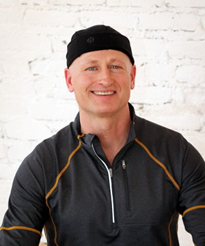 """Chris' interest in yoga started around 2005 as a way to develop greater flexibility and strength to support other athletic activities: running, biking, and swimming.  Through the practice of yoga, he became interested in its open and accessible philosophy; it's focus on body awareness and how the teachings of yoga can easily be applied to daily life. As his yoga teachers often say, """"its all yoga"""".  In 2010, Chris completed his first 200-hour teacher training and started teaching yoga classes. In 2013, he completed his second 200-hour teacher training at DIG Yoga. """"I feel very fortunate to be able to study under the direction of such gifted and knowledgeable teachers."""" His goals are to continue to develop his personal practice and his teaching practice and to offer classes that are both challenging and fun.  Chris works full time in the I.T. industry and fully appreciates the benefits that a yoga practice offers for both the body and mind."""