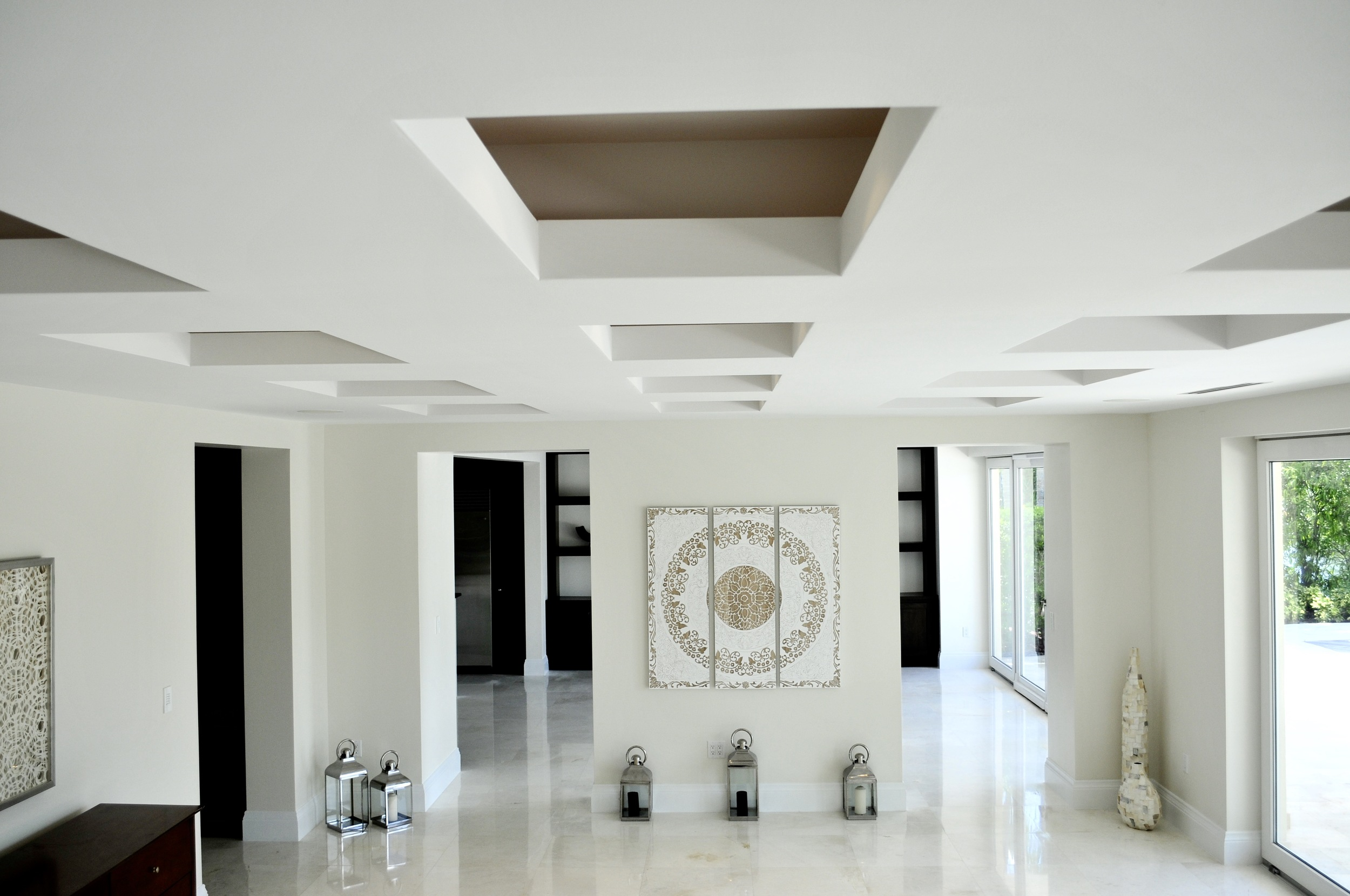 Chocolate box ceiling with LED accent lighting inside. The living room flows in to the kitchen living area..jpg