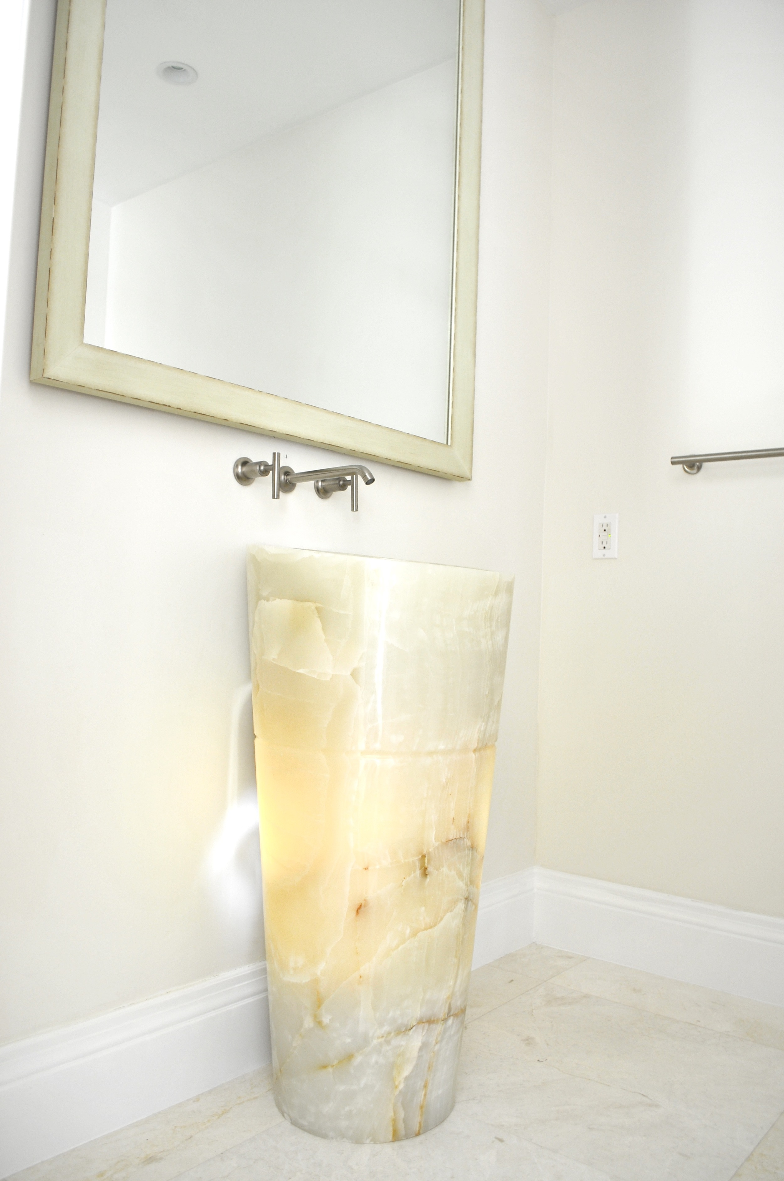 Sink made from one piece of Onyx from Stone Forest To make the pedestal sink interesting we back lit it from the inside.jpg