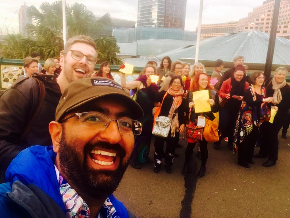 Photo of us organising a happiness flashmob in Sydney outside the Happiness and Its Causes Conference