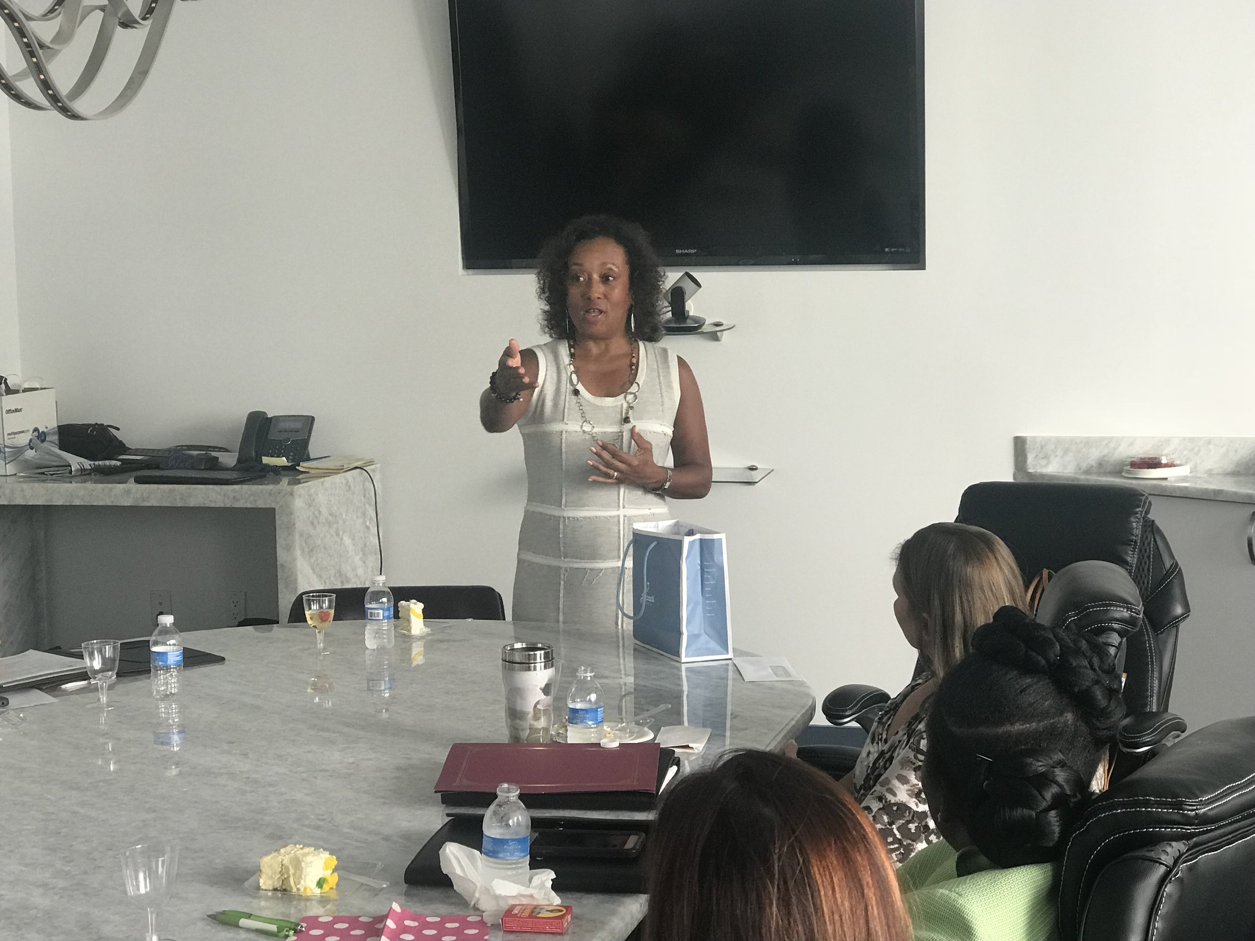 Diana Riley of Swinging With a Purpose speaks to the Dress for Success SW Florida WETES Graduates at Welch Companies of Florida on August 21, 2018