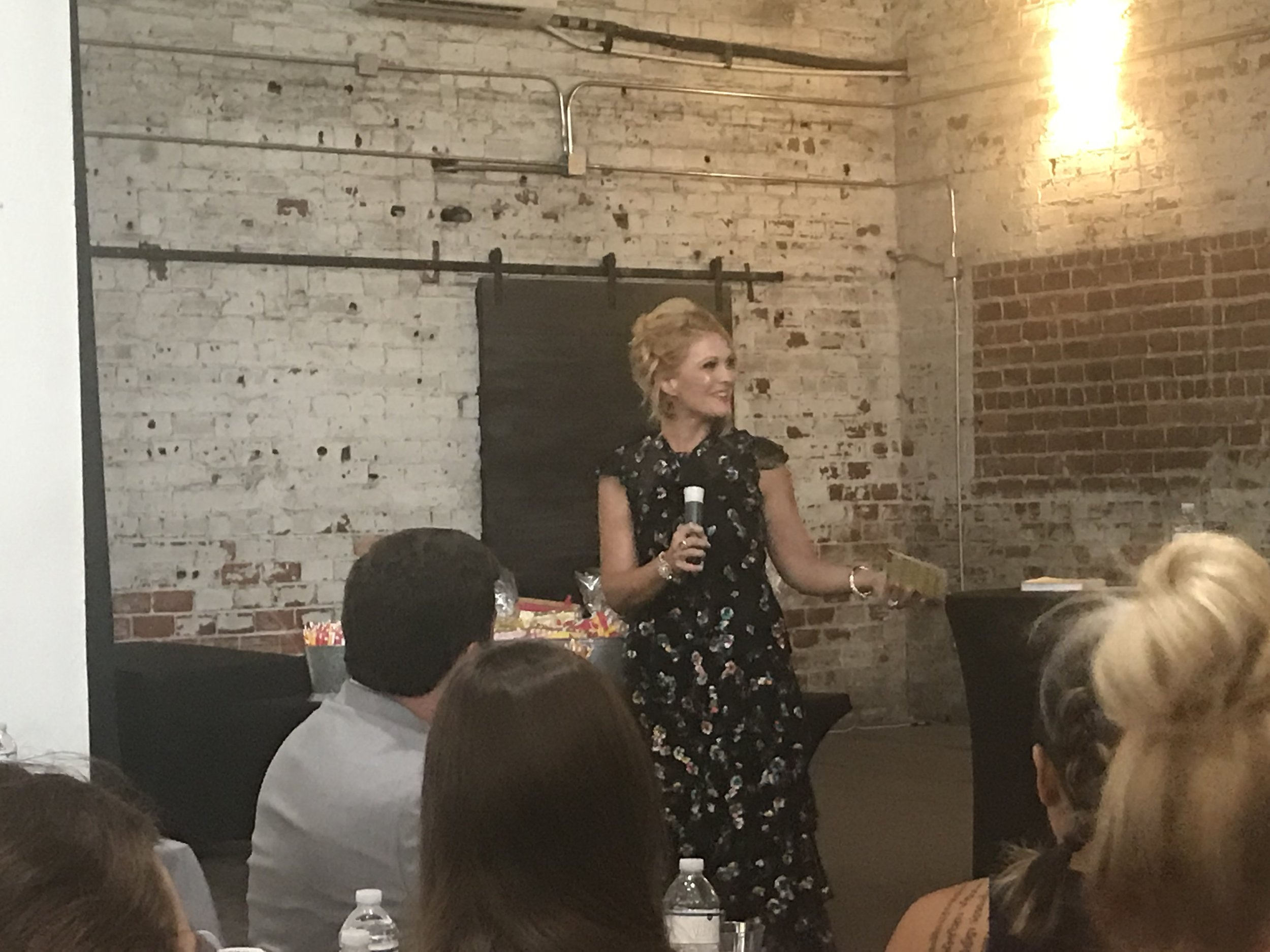 Melanie Griffin presenting at the EKHOS Conversation & Cocktails: Combating Imposter Syndrome at the Rialto Theatre in Tampa and August 8, 2018