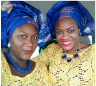 Mrs Abdulkareem in our Electric blue sand bead necklace.jpg