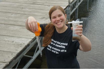 Dawn modeling the turkey baster used to take an epilithic diatom sample at Spirit Lake, Iowa.