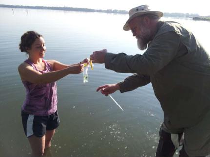 Ana collecting  Aphanizomenon  in Lower Gar Lake.