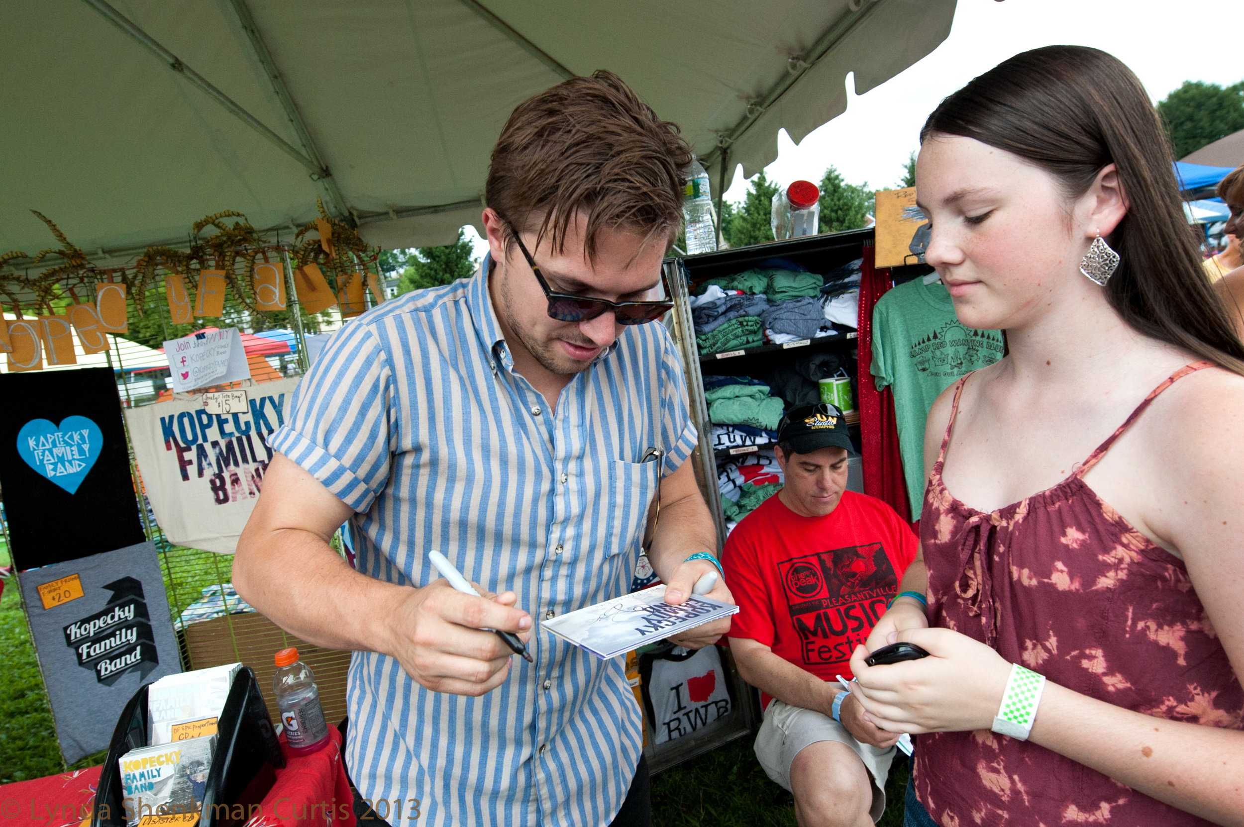 Autographs at the merch tent with the Kopecky Family Band © 2013 Lynda Shenkman Curtis