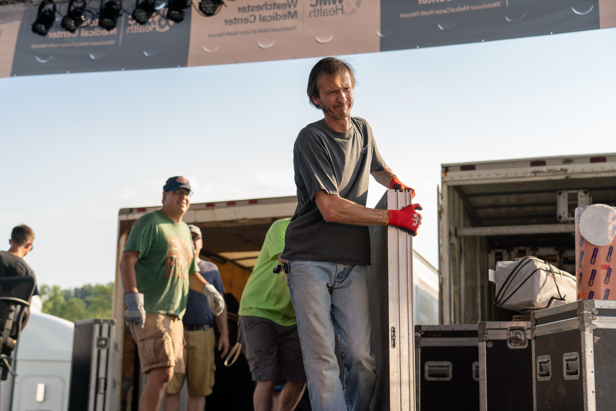 Party Stage Crew Chief Glen assembling the Main Stage © 2018 Jonathan Cunningham