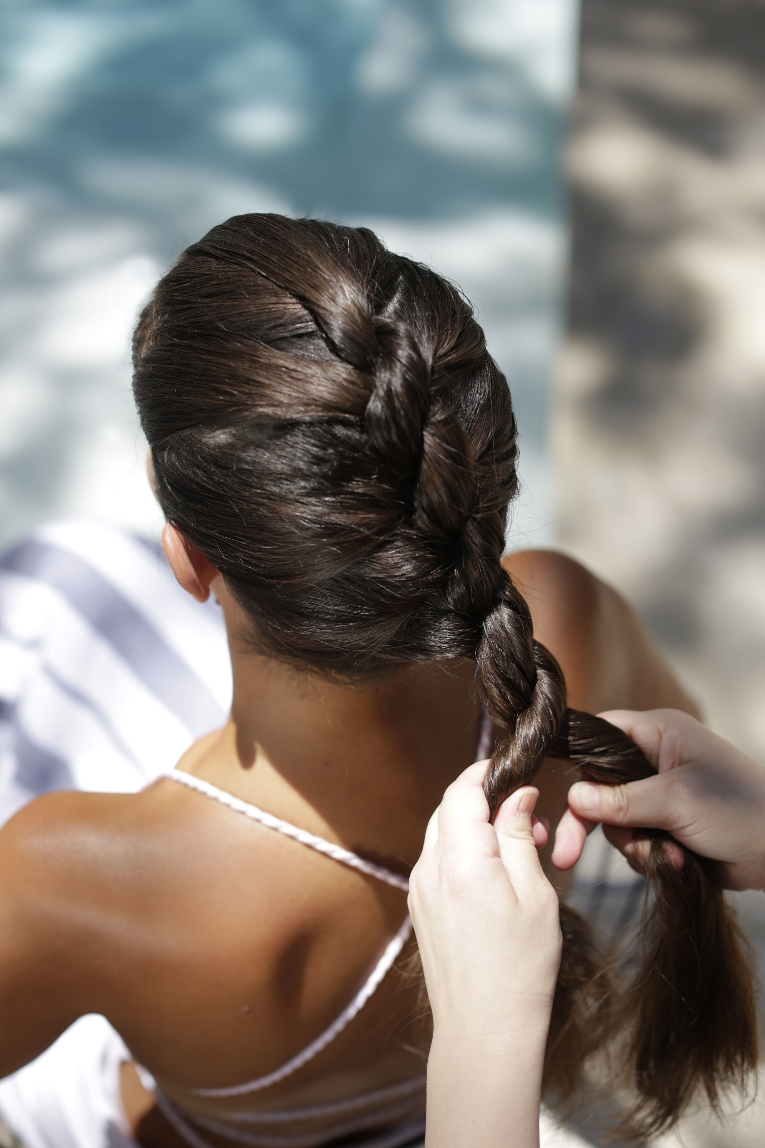 - Twist each strand of hair clockwise as you wrap them around each other