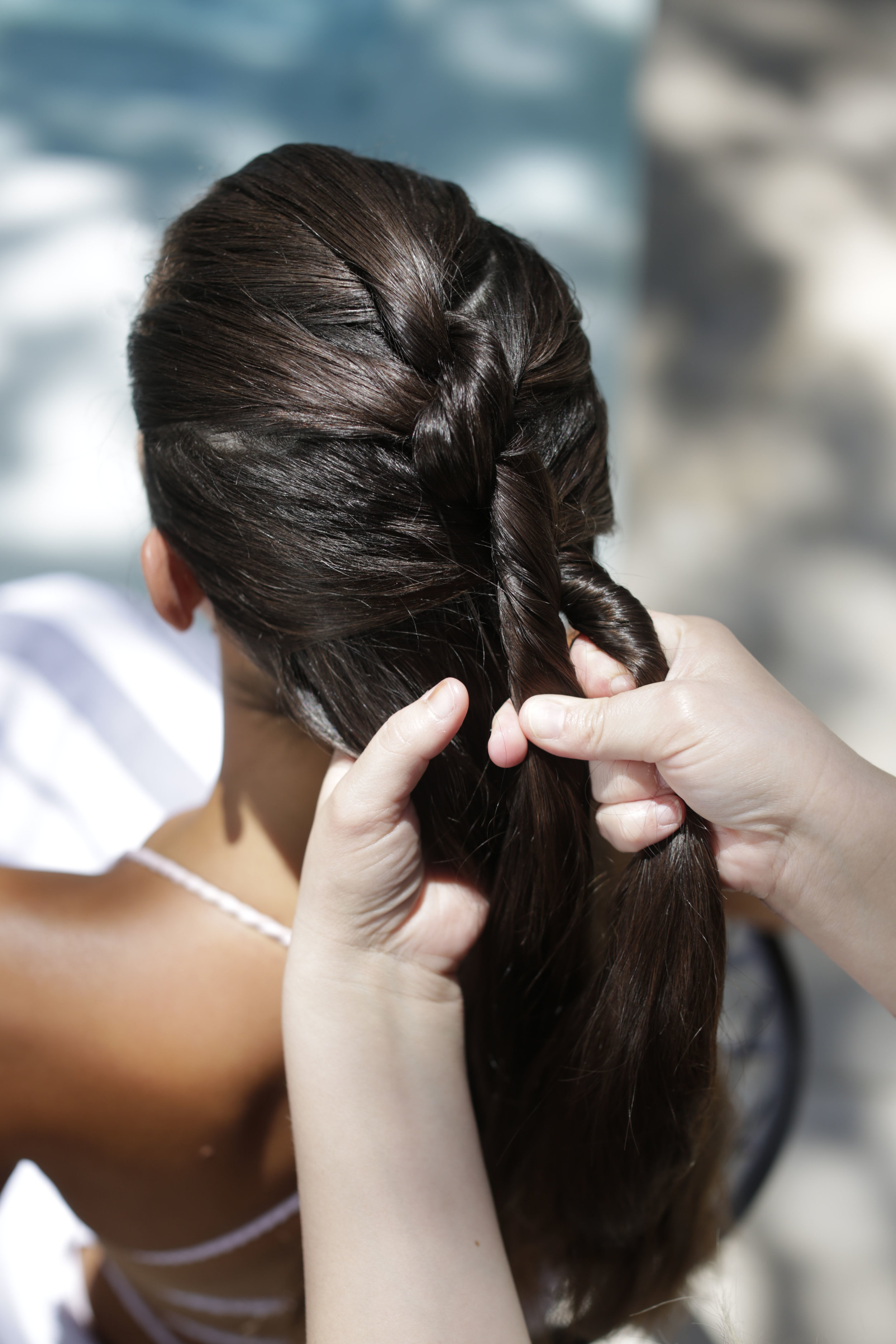 Step 1 - Grab a section of hair while keeping your grip on the right hand
