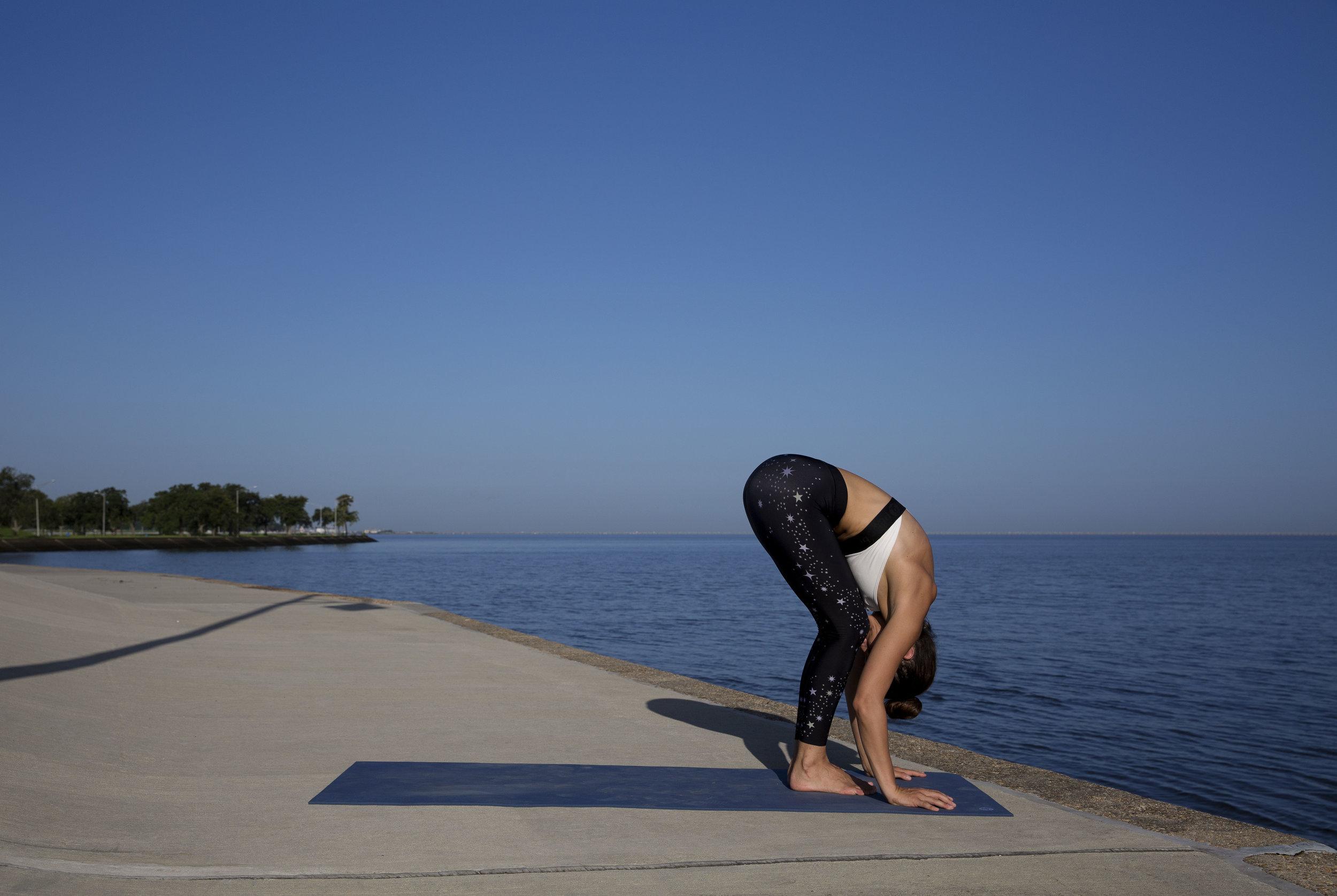 Exhale forward fold