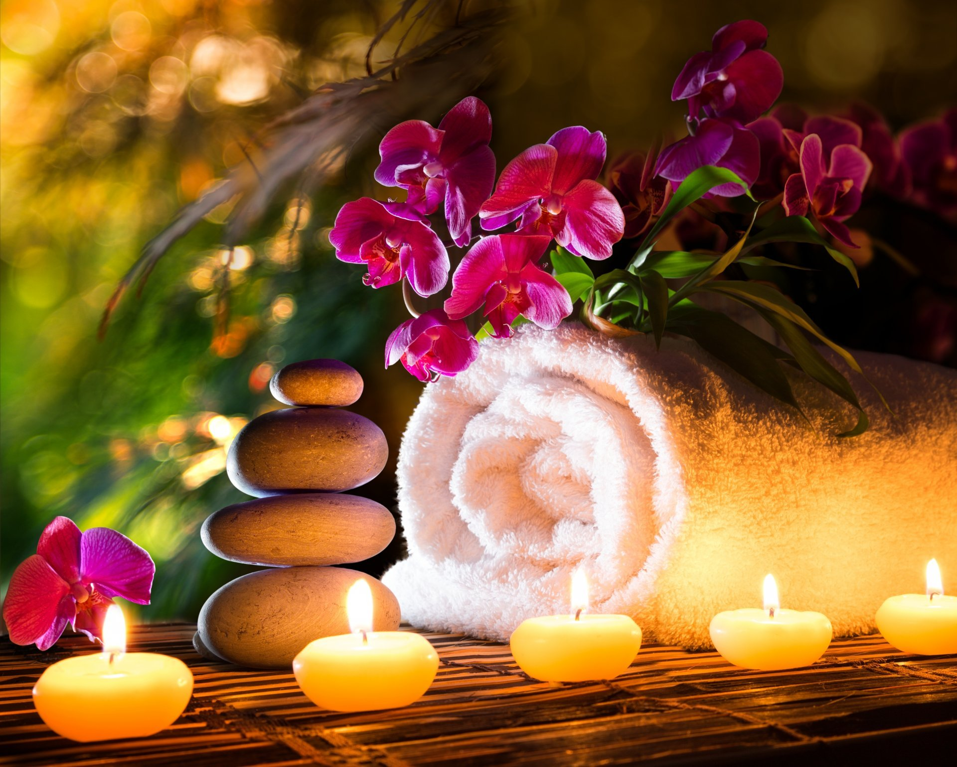 towel-spa-stones-candles-flower-orchid.jpg