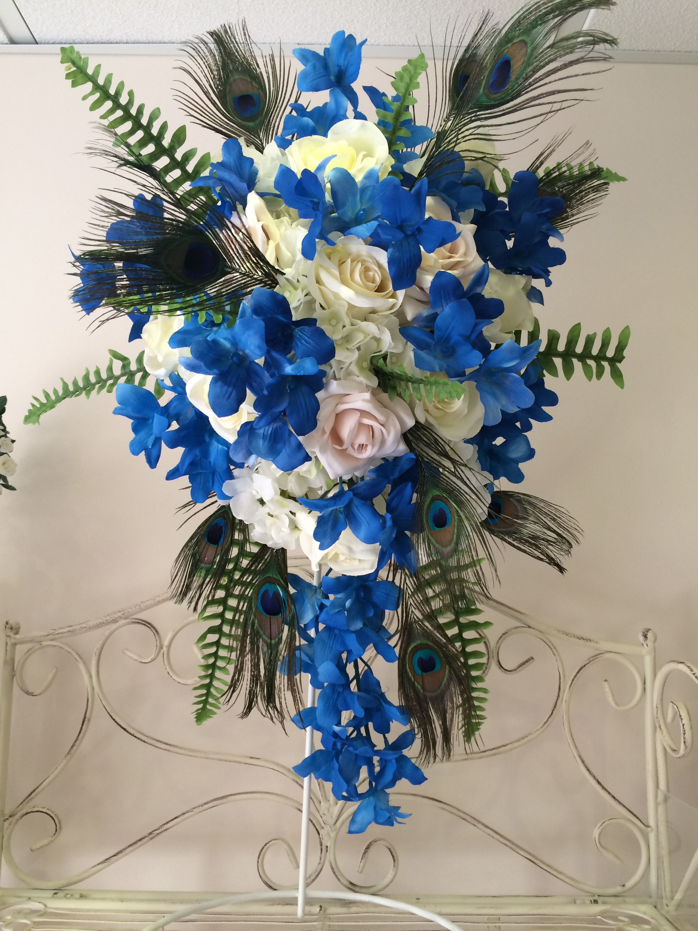Very Long Teardrop Bouquet With Electric Blue Orchids, Cream Roses, Hydrangeas & Peacock     Feathers