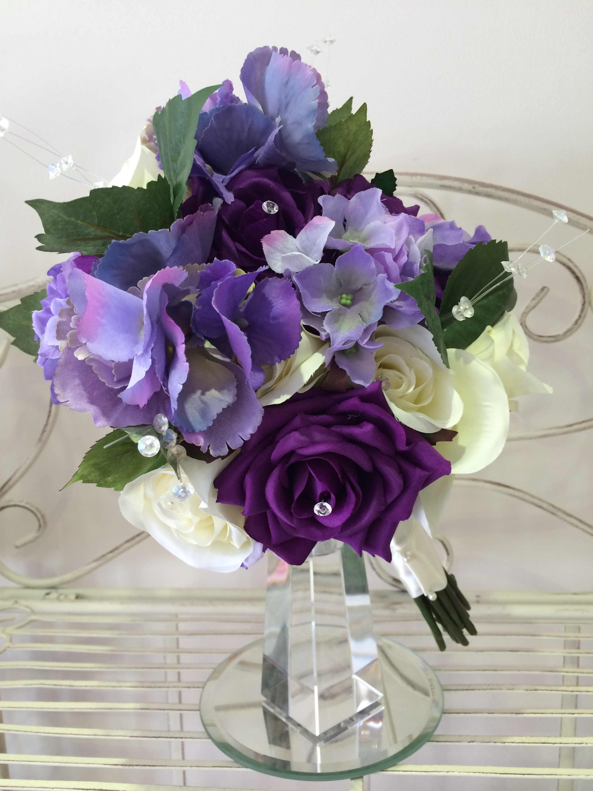 Brides Handtied Bouquet With Cadbury Purple Roses, Lilac Hydrangeas & Cream Roses