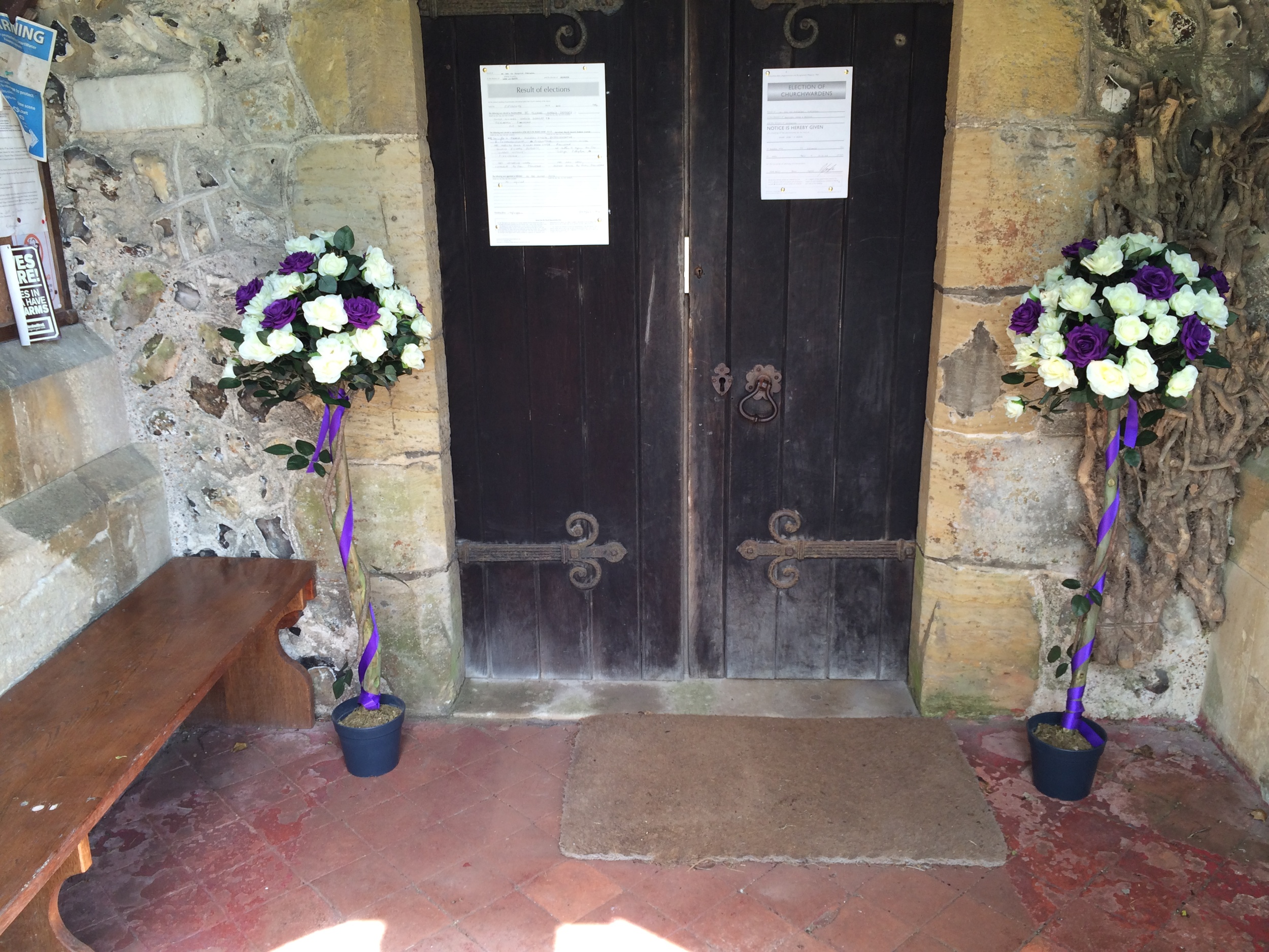 4ft Ivory Ross Bushes With Purple Roses, Either Side The Church Doors