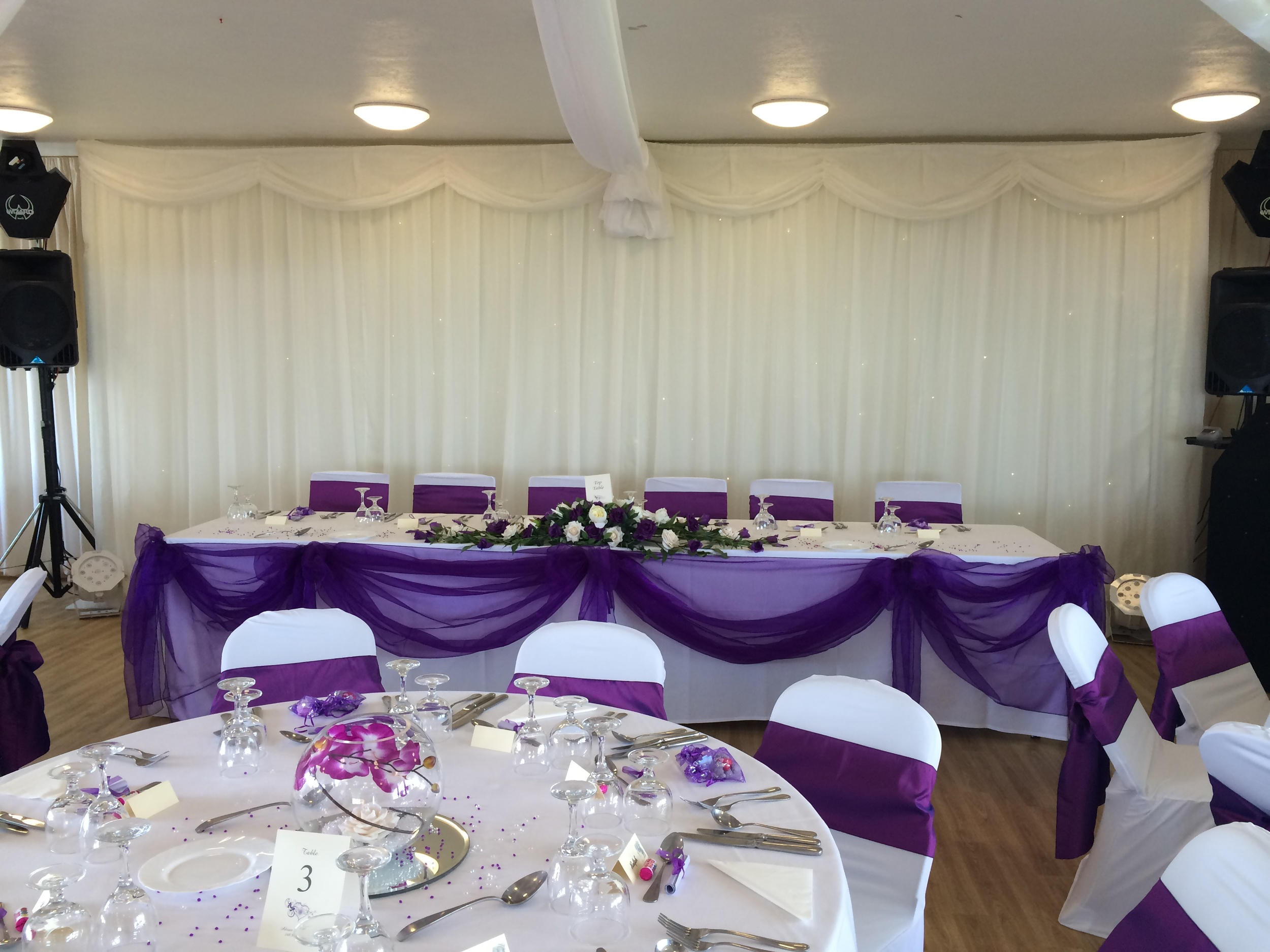 Top Table Display - With Cadbury Purple & Ivory Roses,  Purple Orchids & Bayleaves