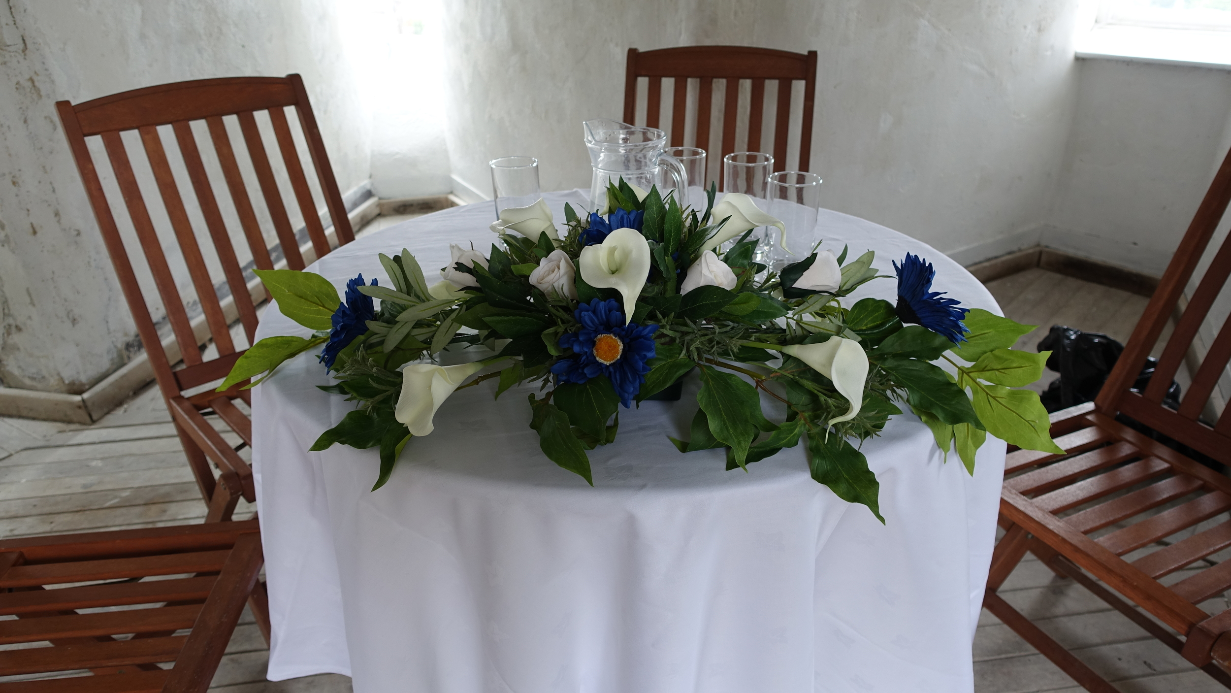 Ceremony Table Display - Dark Blue Gerberas, Ivory Calla Lilies, With Peony & Herb Leaves