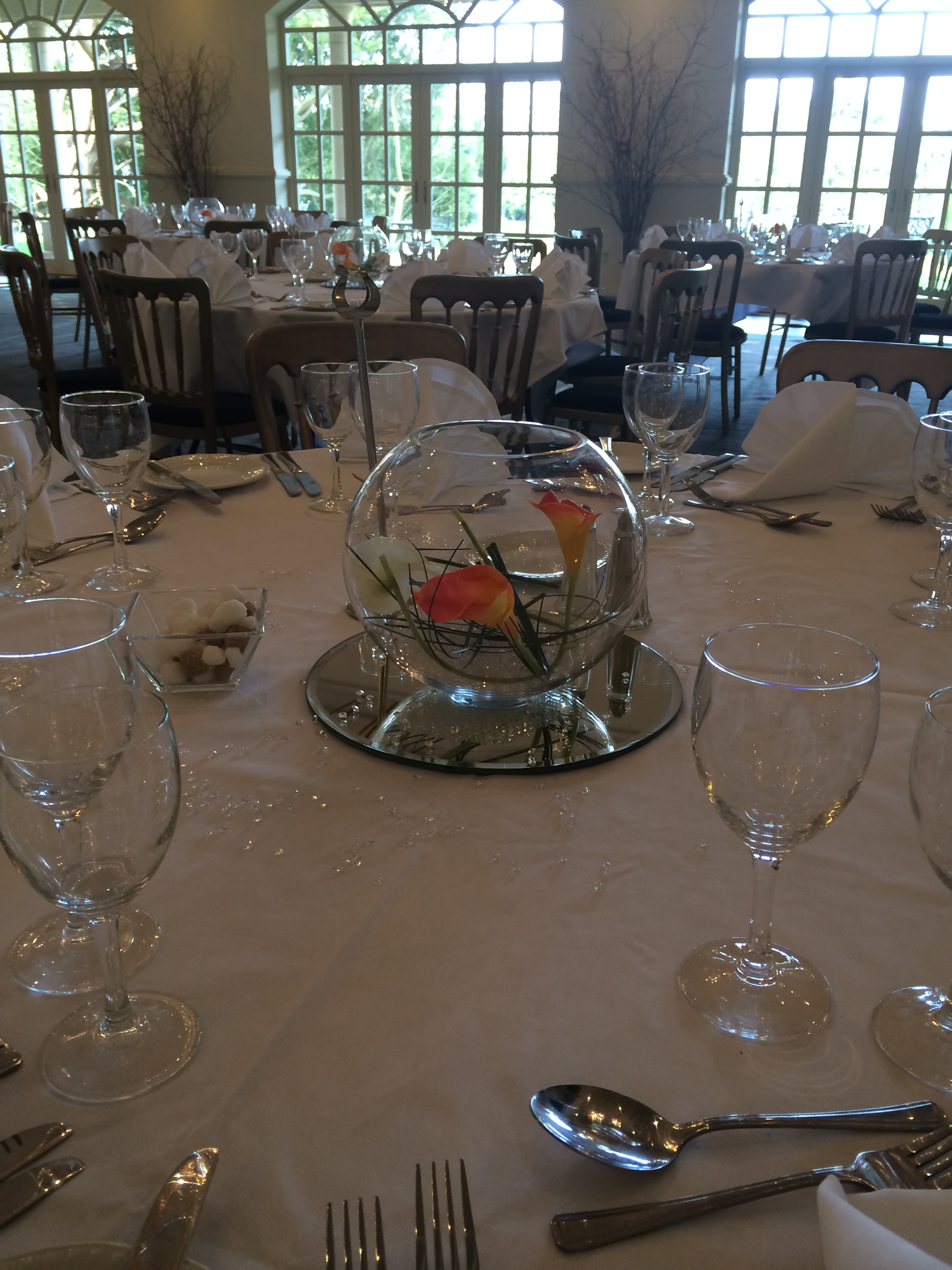 Guest Table Display - Gold Fish Bowl On A Mirror Plate, With Orange & Ivory Calla Lilies