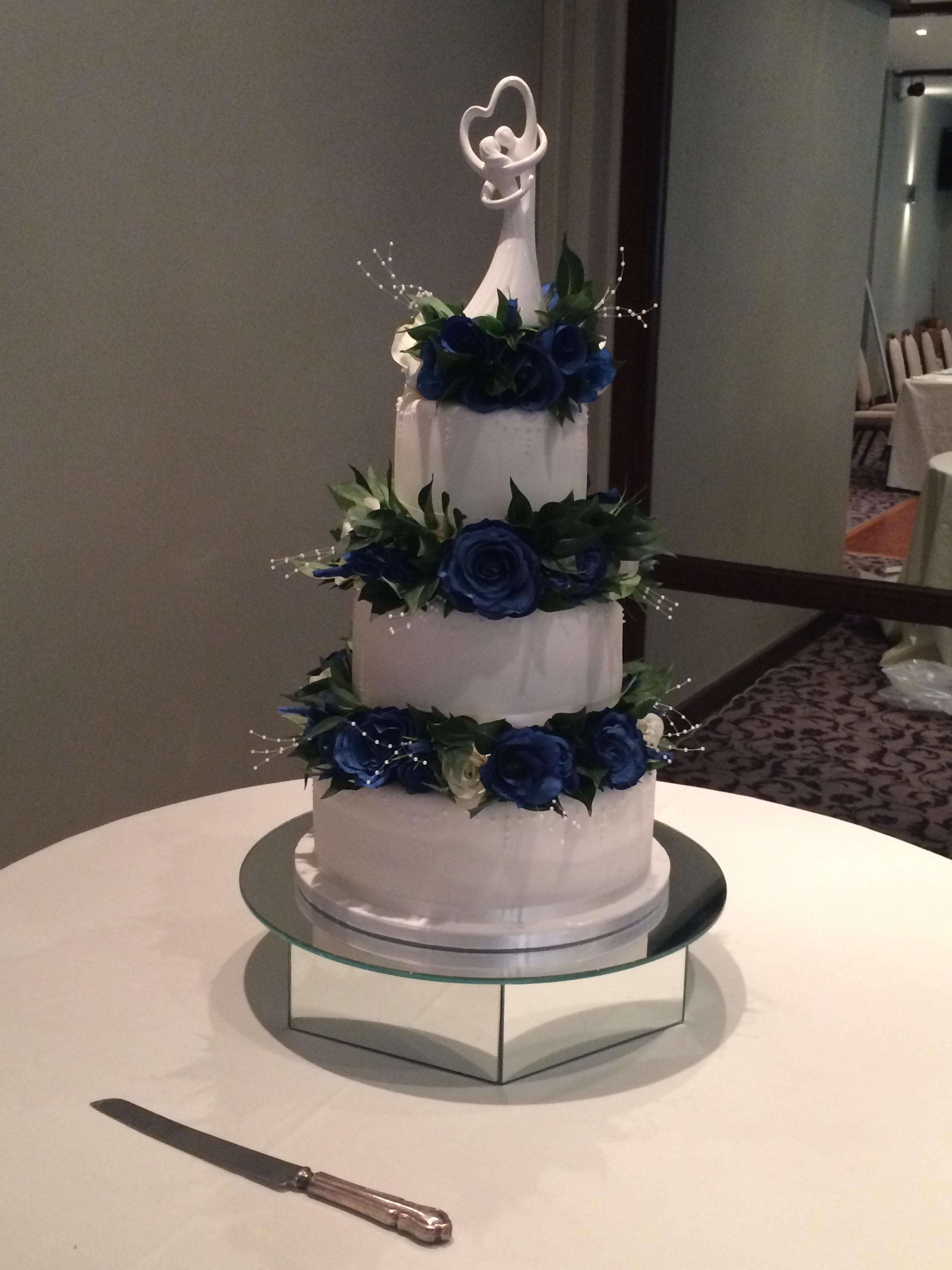 Wedding Cake Flowers - Stacked Arrangement With 3 Layers Of Dark Blue & Ivory Roses With Bayleaves