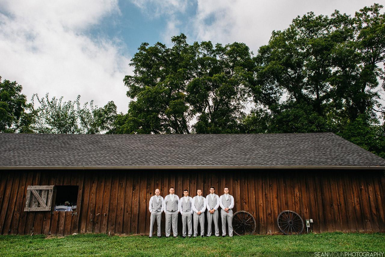 016-groomsmen-wedding-portrait-group-barn-zionsville-eric-uhlir-indiana-24mm-wide-angle.jpg