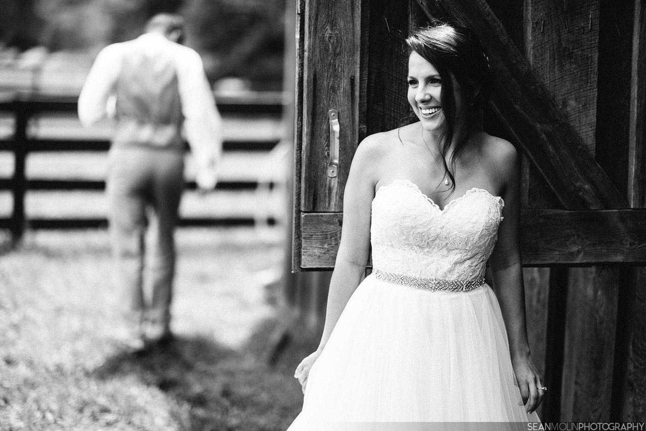 020-bride-groom-first-look-cute-black-white-barn-zionsville-indiana.jpg
