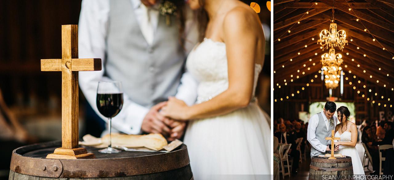 058-wedding-ceremony-communion-bread-cross-wine-christian-barn-zionsville-indiana.jpg