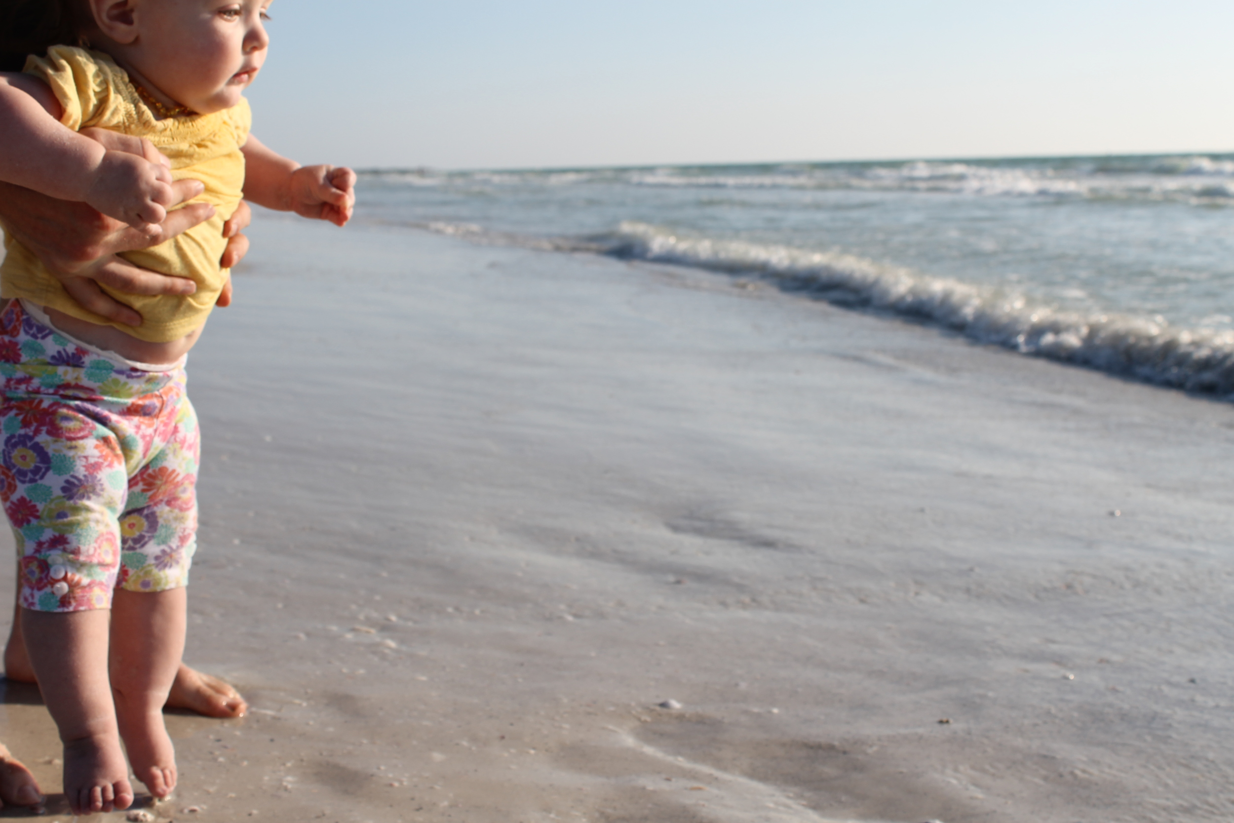 baby and ocean waves