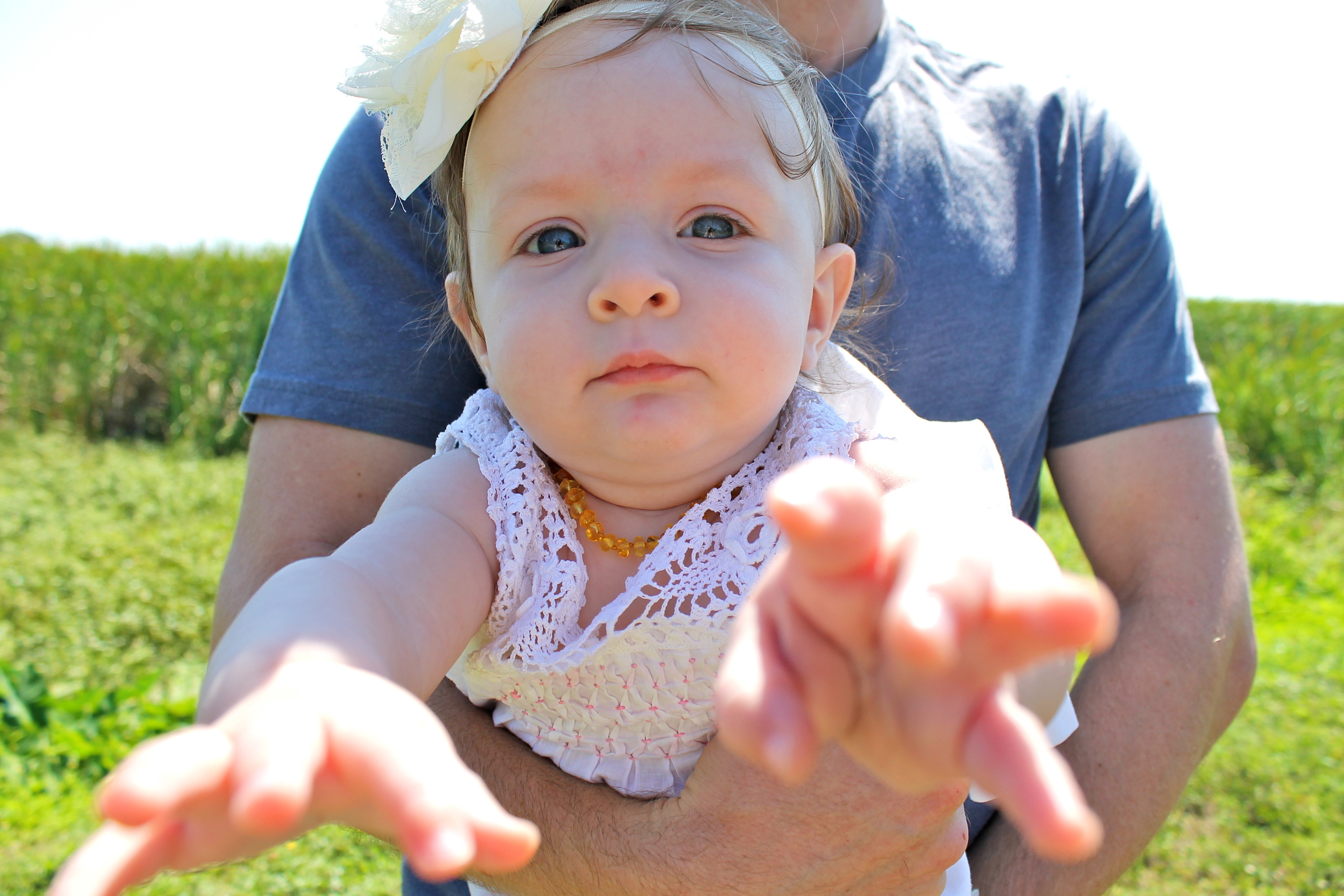 baby reaching for camera
