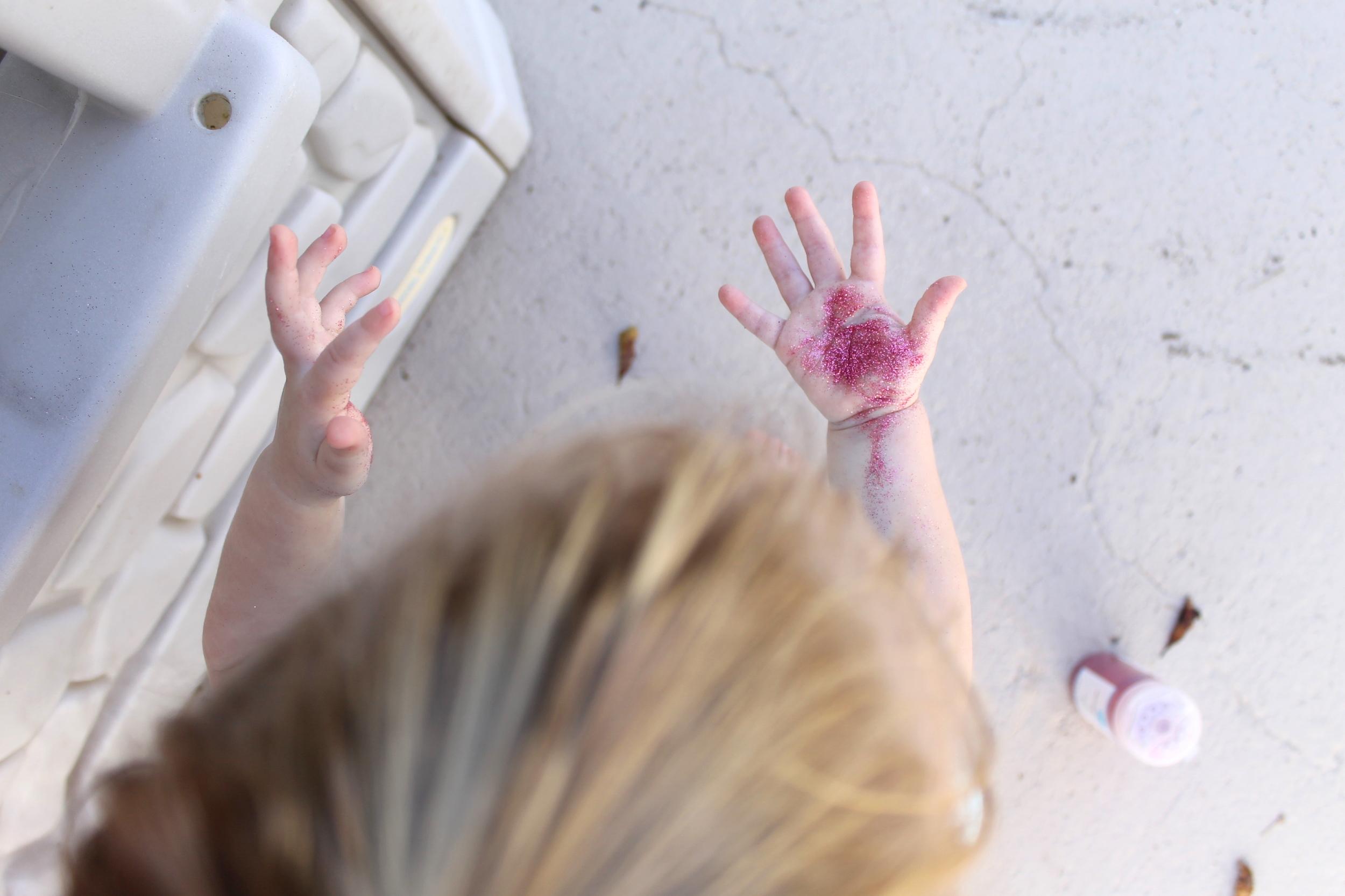 pink glitter baby hands