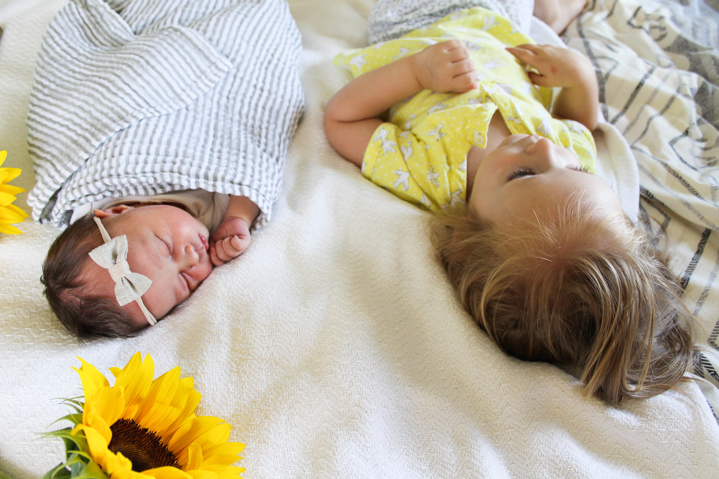 big sister and newborn sunflower photo, little unicorn striped swaddle
