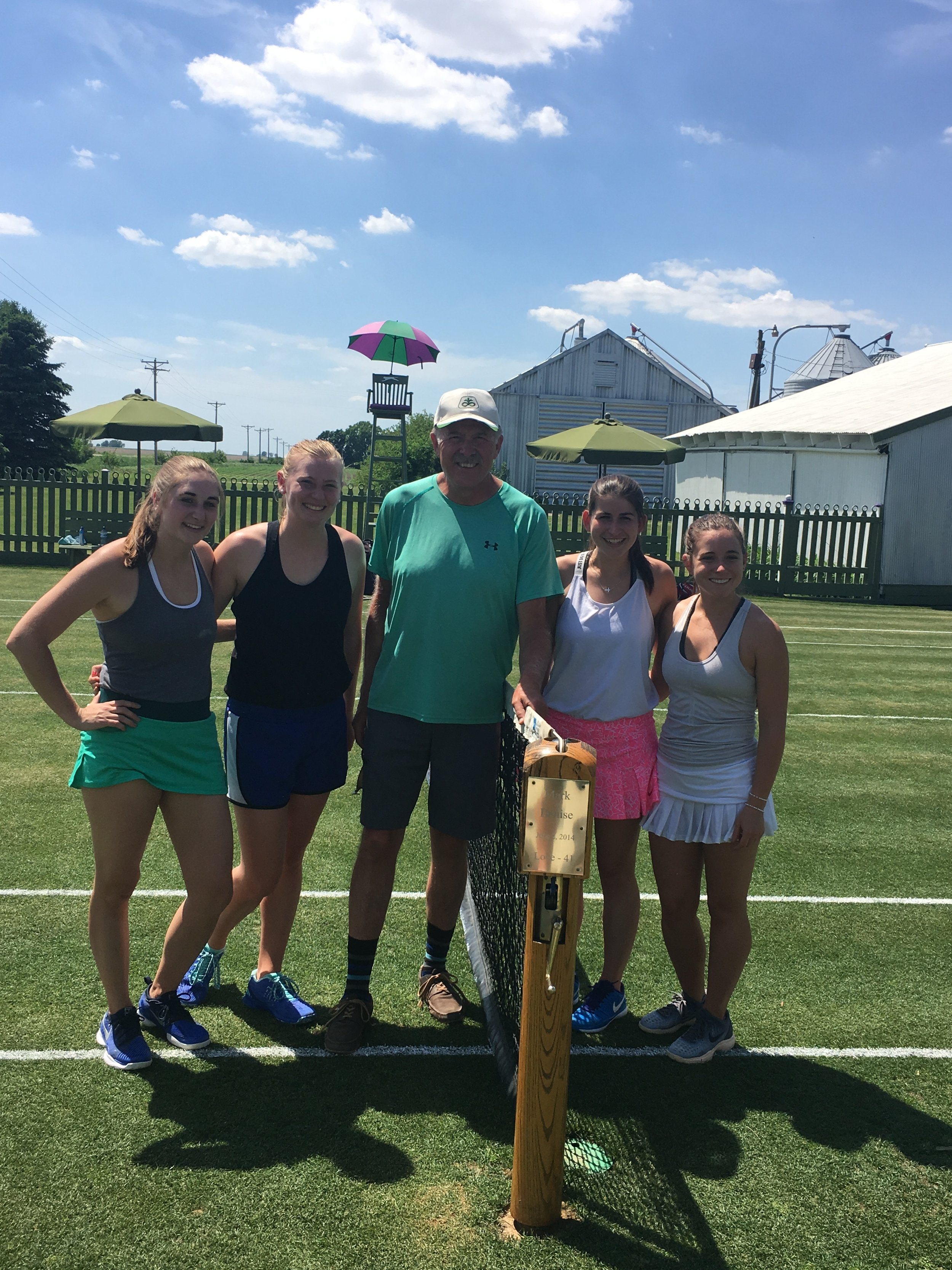 Pictured are members of the 2018-2019 Saint Mary's University of Minnesota women's varsity tennis team and Mark Kuhn