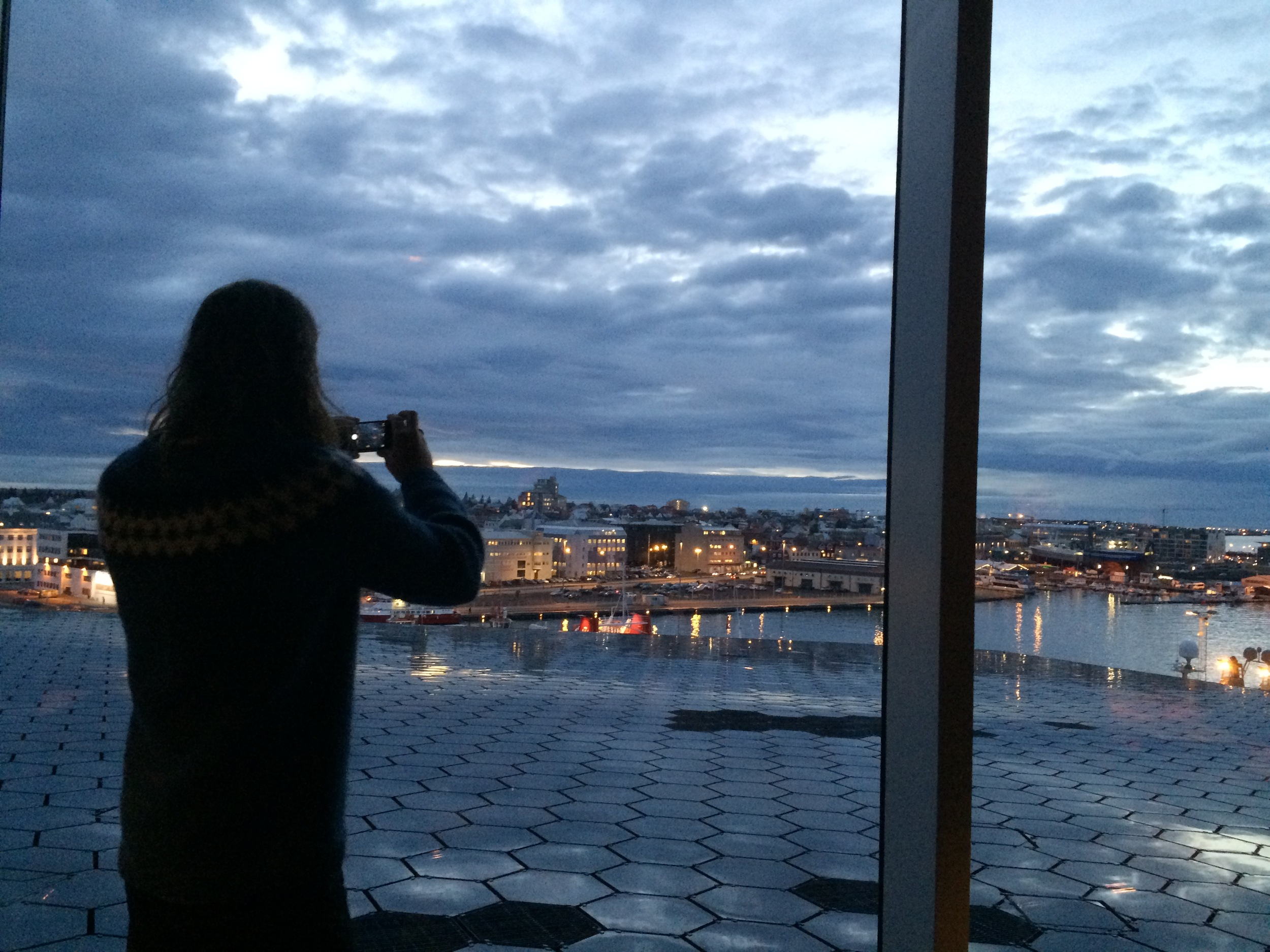 Jed taking a picture of Reykjavik, from Harpa