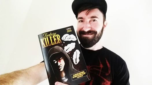 Kevin Hock holding Fantasy Killer issue #1  hot off the presses!