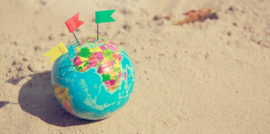 Globe with pins.jpeg