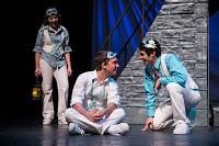 Edelman (left) as Benvolio,Klopatek as Romeo and Powell asMercutio inUSF's touring productionof  Romeo and Juliet.