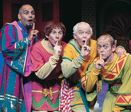 Peter Sham (left) as Marcus Lycus, Brian Vaughn as Hysterium, Fred C. Adams as Pseudolus, and A. Bryan Humphrey as Senex in  A Funny Thing Happened on the Way to the Forum,  1995.