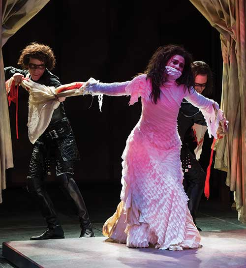 Jeb Burris (left) as Chiron, Melisa Pereyra as Lavinia, and Steve Wojtas as Demetrius, in the Utah Shakespeare Festival's 2012 production of  Titus Andronicus.  (Photo by Karl Hugh. Copyright Utah Shakespeare Festival 2012.)