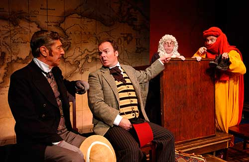 Ian Stuart (left) as Phileas Fogg, Alex Ward as Passepartout, Sam Stewart as Judge Obadiah, and Richard Kinter as Young Parsi in the Utah Shakespeare Festival's 2001 world première production of  Around the World in 80 Days.
