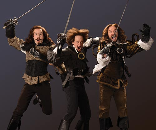 Tasso Feldman (left) as Aramis, J. Todd Adams as Athos, and Todd Denning as Porthos.