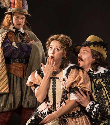 Brandon Burk (left) as Cliton, Betsy Mugavero as Clarice, and Jeb Burris as Dorante in The Liar.