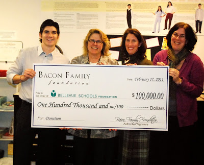 Tony Bacon from The Bacon Family Foundation presents a check to Roxanne Shepherd, Dr. Tracy Maury & Marian McDermott from The Bellevue Schools Foundation.